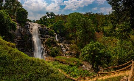 Trail to beautiful Wachirathan waterfall surrounded by lush tropical forest in Doi Inthanon National Park nera Chiang Mai Thailand