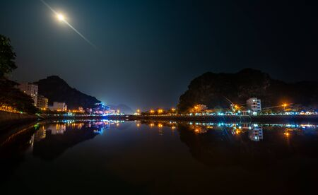 Cat Ba Vietnam Full moon night City Center Reflection in water