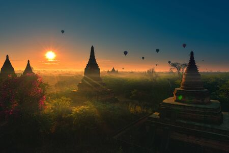Hot air Balloons at Sunrise over beautiful temples Bagan Myanmar