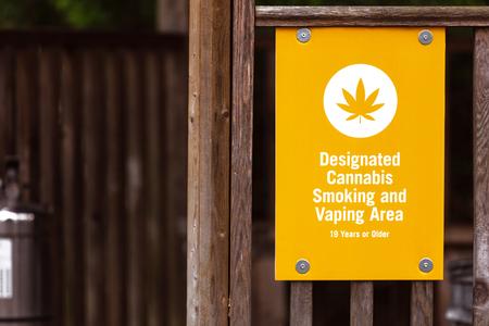Legal Cannabis smoking area sign close up