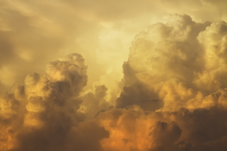 Colorful orange and yellow puffy storm clouds at sunset  photo