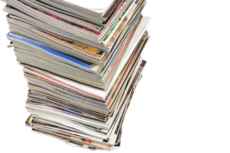 Large stack of magazines on white background  photo