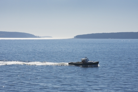 lobster boat: Lobster boat and islands near Acadia National Park Maine