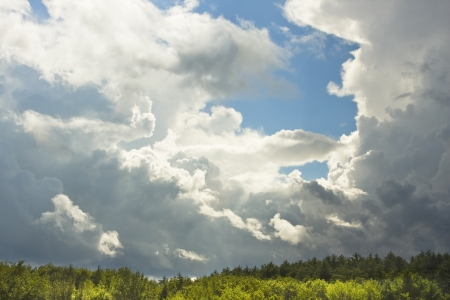 rainclouds: Blue sky and building storm clouds