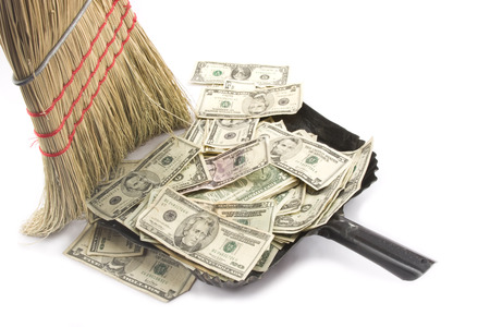 Broom sweeping up American Money