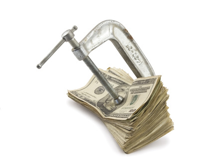 C-clamp putting pressure on American Money  photo