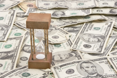 Hourglass on background of American currency  photo