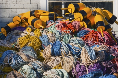Pile of lobster fishing gear on dock in Maine  photo