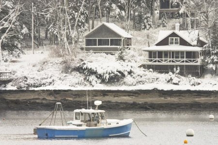 lobster boat: Fishing boat after winter snowstorm in Tenants Harbor, Maine