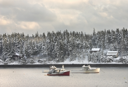 lobster boat: Lobster fishing boats after winter snowstorm in Tenants Harbor, Maine  Stock Photo