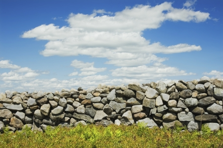 rockwall: Stone wall with blue sky and clouds