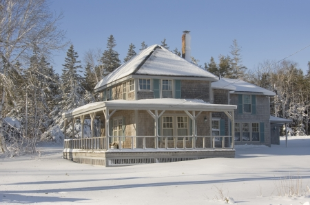 winter: Summer home after snowstorm in coastal Maine