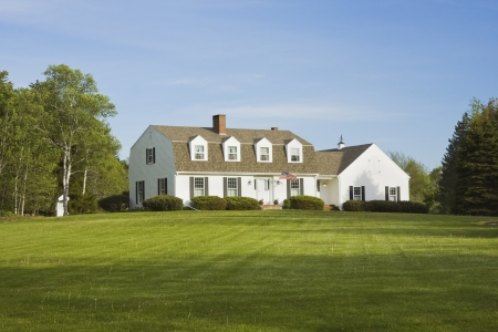country house style: Gambrel style house in summer  Editorial
