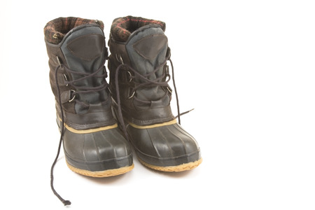 Insulated winter work boots isolated on white background  photo