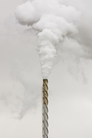 smoke stack: Factory steam billows from smoke stack  Stock Photo