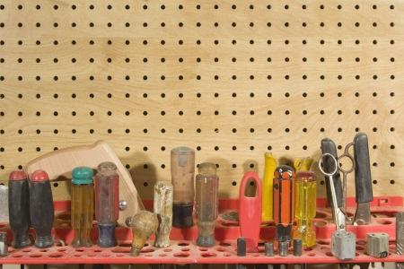 pegs: Various tools and equipment stored in workshop  Stock Photo