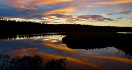 Sunset reflecting off Seawall Pond, Acadia National Park, Maine  photo