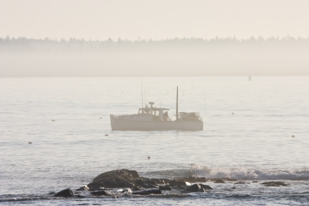lobster boat: Lobsterman works between Seawall Beach and Big CranBerry Island, Mount Desert Island, Maine