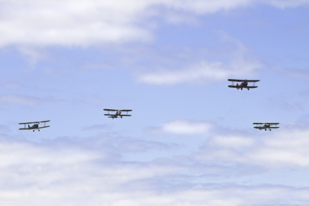 1931 Waco UBF-2; 1917 SPAD XIIIc I; 1917 NIEUPORT 28C 1 and De Havilland DH-82A Tiger Moth biplanes flying in sky
