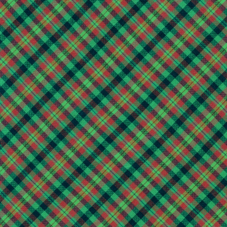 Brightly colored green red and black plaid textile background. photo