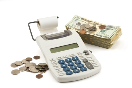 Money and Calculator on white Background  photo