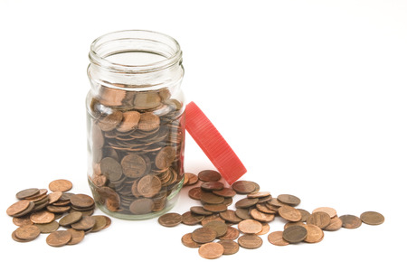 pennies:  Pennies and jar on white background