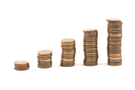 pennies:  Pennies on white background symbolizing economic growth