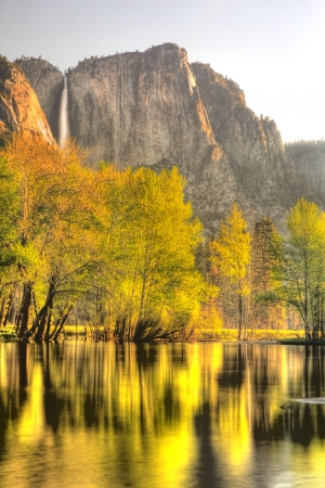 Yosemite Falls in Yosemite National Park taken from Swing Bridge at sunrise in the spring photo