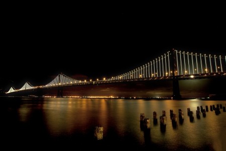 The San Francisco Bay Bridge is lit up at night with the  48,000 LED light sculpture by artist Leo Villareal
