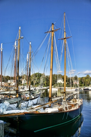 Sailing ships docked in a Maine harbor