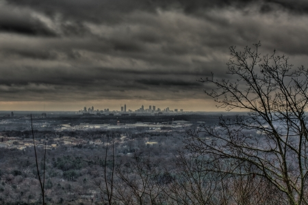 The city skyline of Atlanta as seen from Kennesaw Mountain during a rainy and cloudy Autumn day