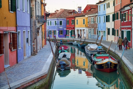 Burano, a small isalnd about 45 minutes from historic Venice is characterized by the colorful buildings built along the small canals