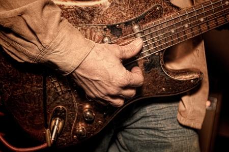 Closeup of a man playing an electric guitar Zdjęcie Seryjne