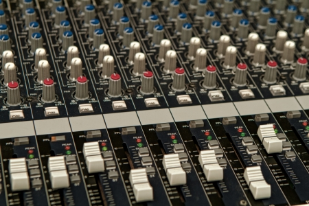 Closeup of a Mixing Console found in recording studios or concert venues Zdjęcie Seryjne
