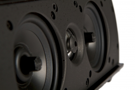 Closeup of an audio speaker resting on its side