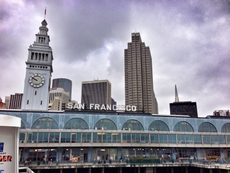 Arriving at the San Francisco ferry building and the city skyline behind it