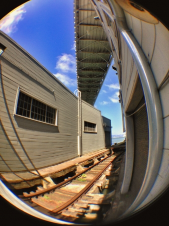 distort: Standing underneath the San Francisco Bay Bridge and shooting with a fisheye lens to distort the image  Stock Photo