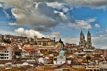 Three churches in historical center of Quito, Ecuador including the twin towers of the Basilica of the National Vow