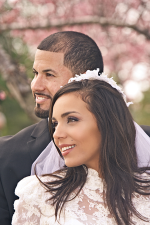 all smiles: A Hispanic bridal couple is all smiles after their wedding