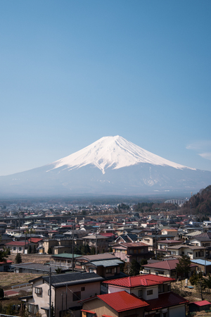 Mt. Fuji over a Provincial City on a Sunny Day