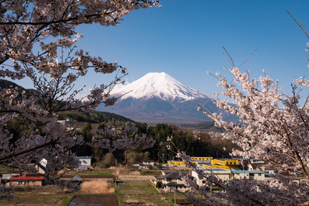 Mt. Fuji over a Town in the Countryside in Spring