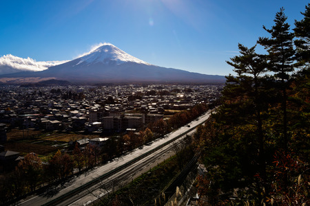Mt. Fuji over a Provincial City and Highway