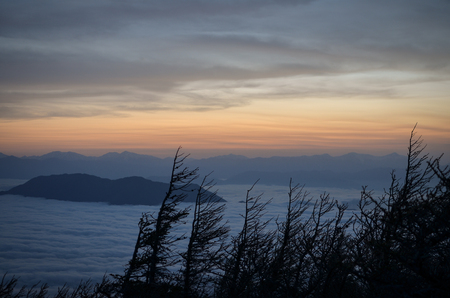 Sunset over a Sea of Clouds Stock fotó