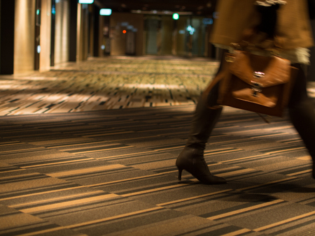 A Woman Walking By Underground Mall at Night