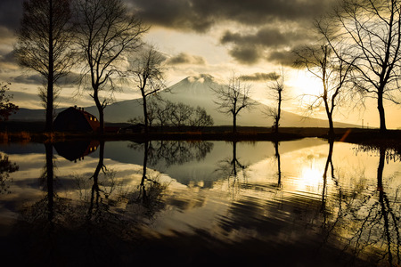 Mt. Fuji and the Sunrise Reflected in a Pond