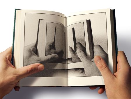 The open book in hand with the image of open book photo