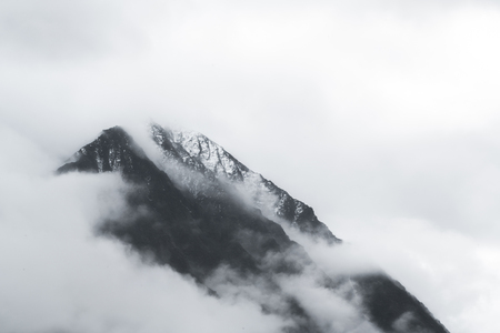 View on mountain in fog in Akkem Valley in Altai Mountains Natural Park aftern rain