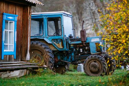 Traktor in vilage in Altai Region near Akkem valley 免版税图像