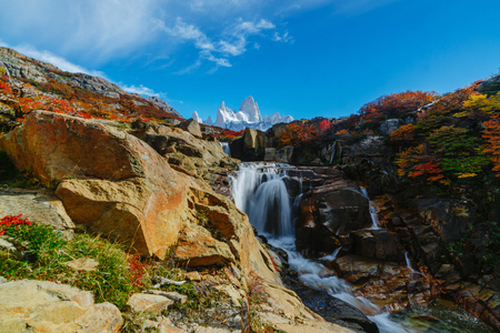 View of the Fitz Roy mountain and the waterfall in the Los Glaciares National Park. Autumn in Patagonia, the Argentine side