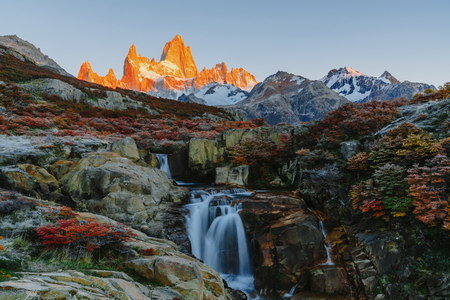 View of Mount Fitz Roy and the waterfall in the Los Glaciares National Park during sunrise. Autumn in Patagonia, the Argentine side Stok Fotoğraf